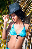 Caribbean woman with black hat. Beautiful caribbean woman with black hat  posing under the palm on a Caribbean island Stock Image