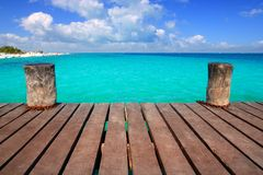 Caribbean wood pier with turquoise aqua sea. Blue sky Mayan Riviera Royalty Free Stock Image
