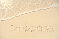Caribbean Written in Sand on Beach Stock Photos