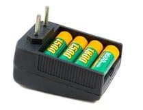 Caricabatteria e batterie Immagini Stock
