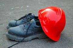 Caricamenti del sistema del lavoro e del cappello duro Fotografia Stock