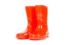 Caricamenti del sistema di pioggia rossi dei bambini Fotografia Stock