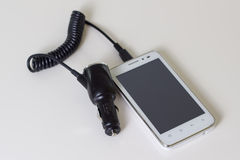 Caricatore dell'automobile del telefono cellulare Fotografia Stock Libera da Diritti