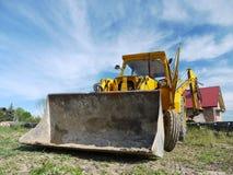 Caricatore dell'escavatore a cucchiaia rovescia immagine stock