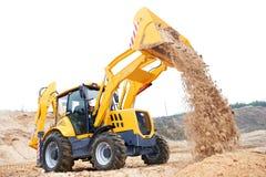 Caricatore di escavatore con gli impianti dell'escavatore a cucchiaia rovescia Fotografia Stock Libera da Diritti