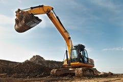 Caricatore di escavatore nella costruzione Immagine Stock