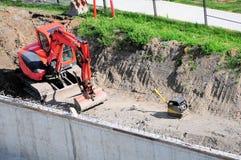 Caricatore-escavatore a cucchiaia rovescia Fotografia Stock