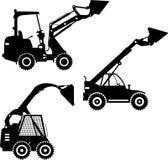Caricatori del manzo di scivolo Macchine della costruzione pesante Fotografia Stock
