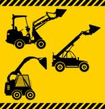 Caricatori del manzo di scivolo Macchine della costruzione pesante Fotografia Stock Libera da Diritti