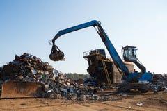 Caricatrice di lavoro del residuo di metallo Immagine Stock Libera da Diritti