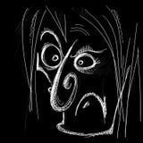 Caricatura diabolica di un viso umano Fotografia Stock