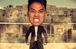 Caricature of an angry man. Caricature of an angry asian man on a western background royalty free stock photography