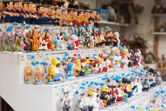 Caricature catalan caganers on counter Stock Image
