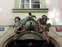 Caricatured Figures Above Puppet Theatre Entrance, Prague Stock Image