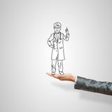 Caricatures of businessman in palm. Drawn businessman in female palm on gray background stock photos