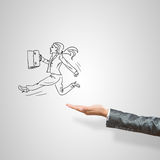 Caricatures of businesswoman in palm. Drawn businesswoman in female palm on gray background stock image