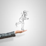 Caricatures of businesswoman in palm. Drawn businesswoman in female palm on gray background Stock Images
