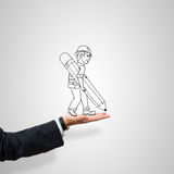 Caricatures of engineer man. Drawn construction man in male palm on gray background royalty free stock images