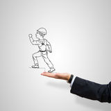 Caricatures of engineer man. Drawn construction man in male palm on gray background stock photos
