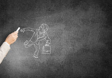 Caricatures of running businessman. Female hand drawing with chalk running businessman on blackboard Royalty Free Stock Photo