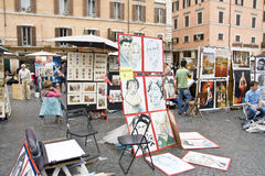 Caricatures for sale. In Piazza Navona in Rome Italy stock images
