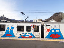 Caricatures of the volcano. Japan - January 29, 2015: Cheerful passenger train with colorful caricatures of the volcano, transporting people to the foot of the stock image