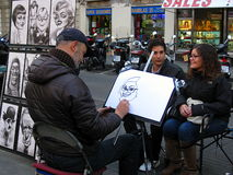 A caricaturist in action in La Rambla Stock Photography