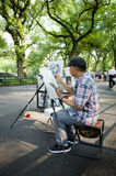 Caricaturist on The Mall in Central park drawing Royalty Free Stock Image