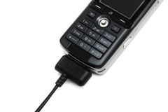 Carico del telefono mobile Immagini Stock