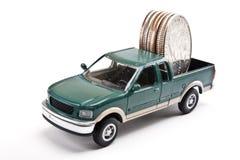 Carico di camion di soldi Immagini Stock