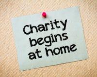 A caridade começa por nós próprios foto de stock