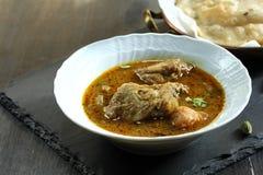 Caril da galinha de Kerala servido com Pathiri Fotos de Stock Royalty Free