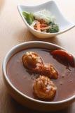 Caril de tomato - curry del tomate y de la gamba Fotos de archivo