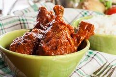 Caril dos pilões de galinha com arroz imagens de stock royalty free