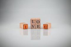 Carimbando o alfabeto dos blocos soletrou EU TE AMO o vint fotos de stock royalty free