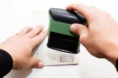Carimbando o passaporte Foto de Stock