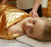 Caring About Beauty. Body Wraps In Spa Salon Stock Photo