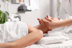 Caring about beauty. Facial massage in spa salon Royalty Free Stock Image