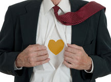Caring business man with heart of gold Stock Photography