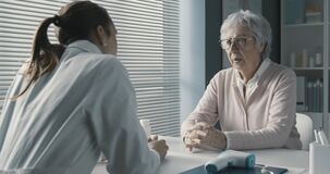 Free Caring Doctor Assisting A Senior Patient Stock Photos - 219898573