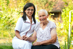 Caring doctor with elderly woman Royalty Free Stock Photography