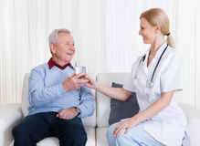 Caring Doctor Giving Water To Patient Royalty Free Stock Photo