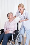Caring doctor helping handicapped patient Stock Photography