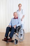 Caring doctor helping handicapped patient Royalty Free Stock Image