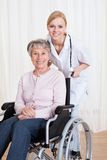 Caring doctor helping handicapped patient Stock Photo