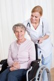 Caring Doctor Helping Handicapped Patient Royalty Free Stock Photos