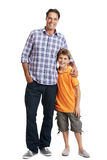 Caring father standing with his cute son Stock Images