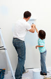 Caring father teaching his son how to paint Royalty Free Stock Photography