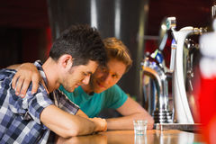 Caring friend comforting upset man Royalty Free Stock Image