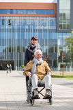 Caring girl and disabled man Royalty Free Stock Photo